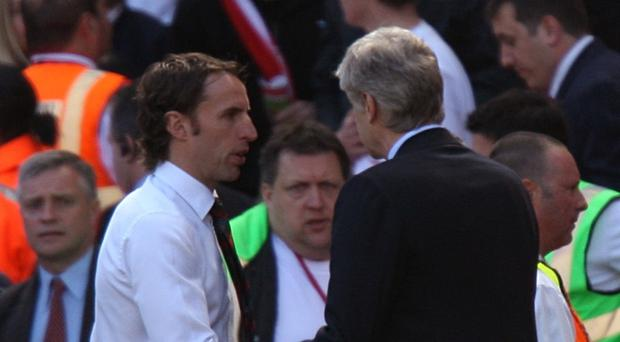 Arsene Wenger, right, came up against new England boss Gareth Southgate when he was in charge at Middlesbrough