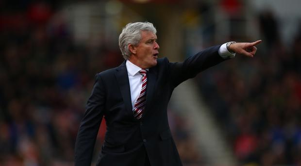 Mark Hughes has seen Stoke pick up six points since he changed formation