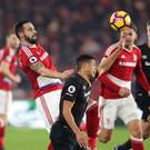 Curtis Davies, centre, could not stop Hull losing at Middlesbrough