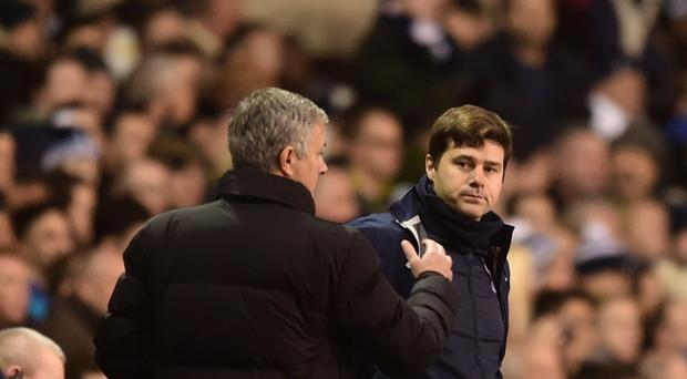 Mauricio Pochettino, right, and Jose Mourinho, left, will go head to head at Old Trafford on Sunday
