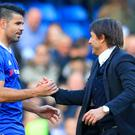 Antonio Conte congratulates Diego Costa, left, on a man-of-the-match display
