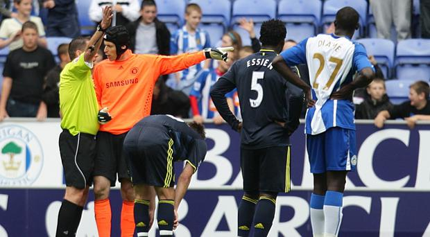 Petr Cech, second left, was sent off as Wigan capped Chelsea's current record winning run at 11