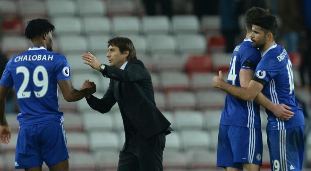 Antonio Conte congratulates his players after Chelsea's win at the Stadium of Light
