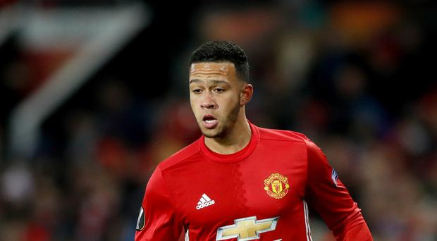 Memphis Depay is attracting interest from Tottenham and Everton