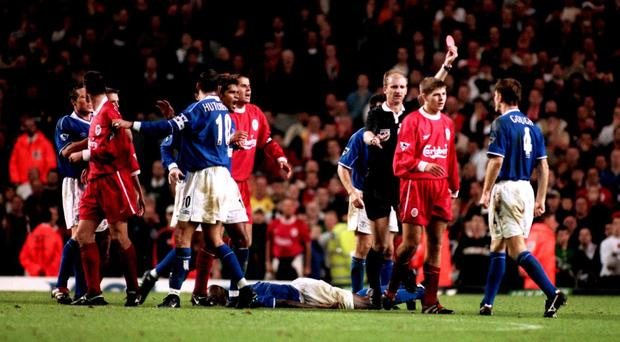 Referee Mike Riley sends off Liverpool substitute Steven Gerrard (second from right) after a tackle on Everton's Kevin Campbell (on floor)