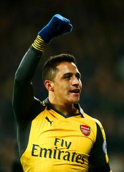 At home: Alexis Sanchez says he is happy at the Emirates