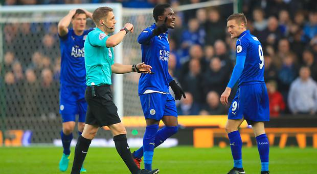 Jamie Vardy, right, is shown the red card by referee Craig Pawson