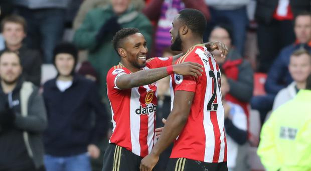 Sunderland striker Victor Anichebe (right) is ready for a battle