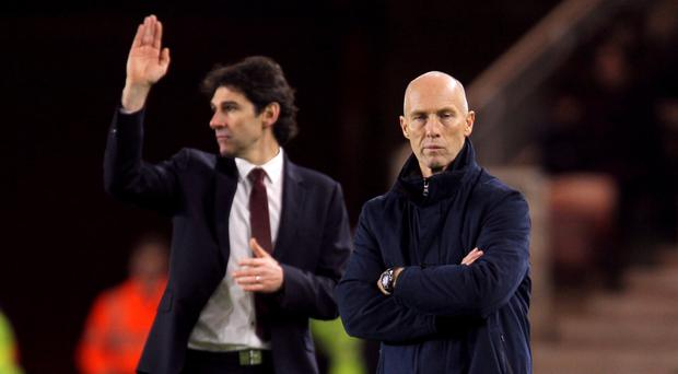 Swansea boss Bob Bradley, right, is under increasing pressure after his side's 3-0 defeat at Middlesbrough
