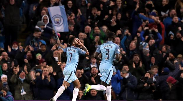 Manchester City's Raheem Sterling celebrates scoring his side's winner