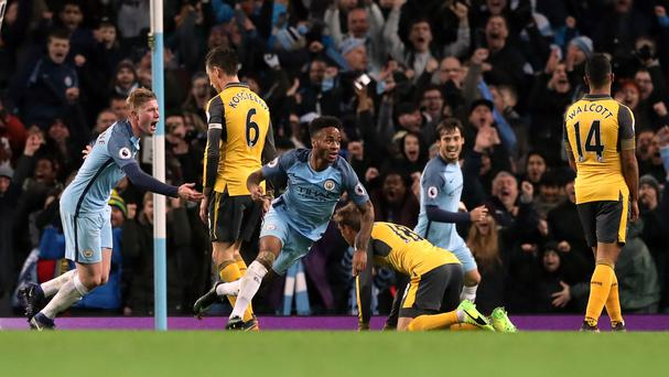 Raheem Sterling, centre, fired Manchester City to victory over Arsenal