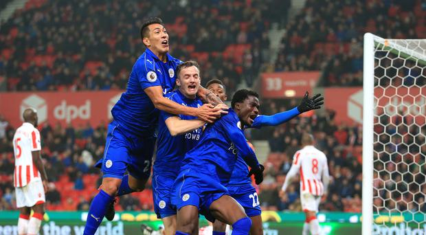 Andy King, centre, celebrates Leicester's late leveller at Stoke