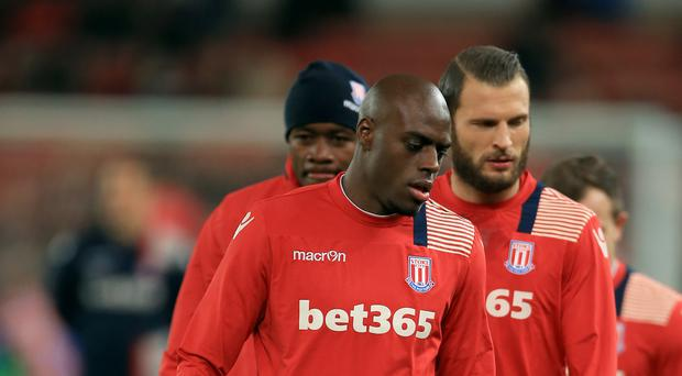 Bruno Martins Indi, centre, has had the booking received by Erik Pieters, right, transferred on to him