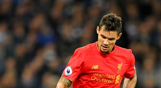 Liverpool defender Dejan Lovren hailed the side's resilience as they kept the pressure on Premier League leaders Chelsea.