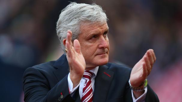 Stoke manager Mark Hughes thinks Chelsea have the edge on Liverpool