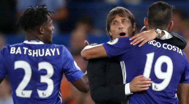 Antonio Conte, pictured centre, is confident Michy Batshuayi, pictured left, can fill the void left by Diego Costa's suspension