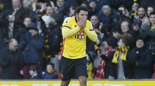 Watford's Troy Deeney scored his 100th goal for the club to secure a 1-1 home draw with Crystal Palace