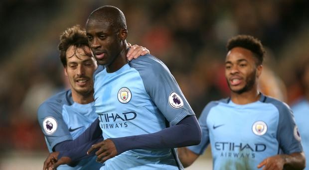 Manchester City's Yaya Toure (centre) celebrates scoring the opener against Hull