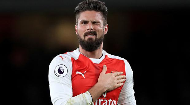 Olivier Giroud secured the points for Arsenal on his first league start of the season