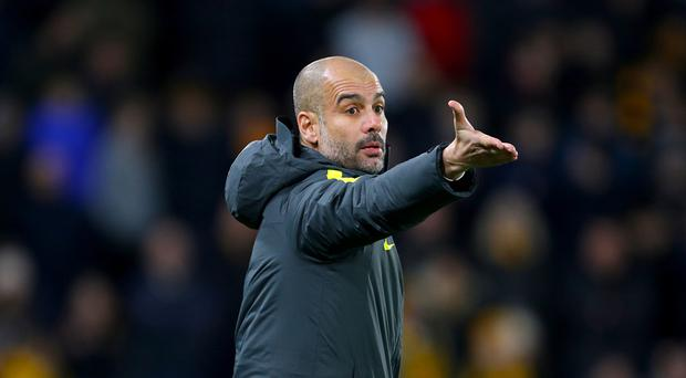 Manchester City manager Pep Guardiola admits the pressure is on in the title race
