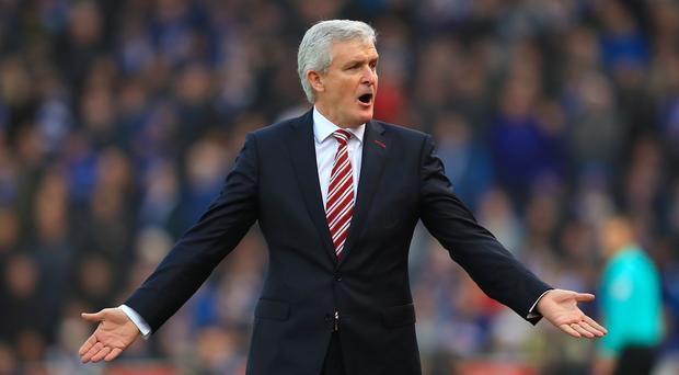 Stoke manager Mark Hughes feels Liverpool's long wait for a 19th Premier League title will have an impact on the players