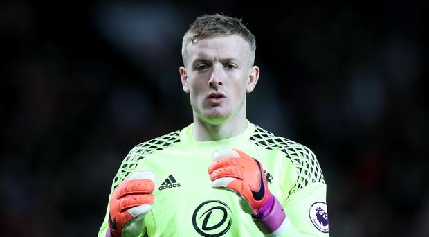 Jordan Pickford hurt his knee at Old Trafford on Boxing Day