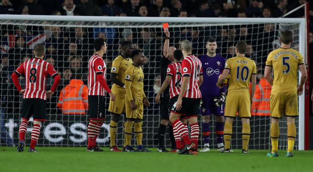 Southampton's Nathan Redmond is shown a red card by referee Mike Dean