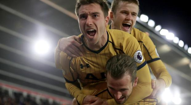 Tottenham celebrate after Harry Kane scores their second goal at Southampton