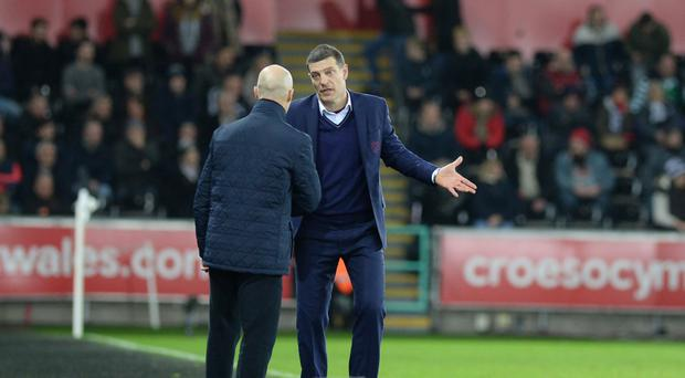 West Ham manager Slaven Bilic (right) was sympathetic towards Bob Bradley (left) following his sacking on Tuesday