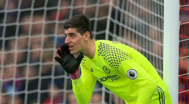 Antonio Conte insists Chelsea goalkeeper Thibaut Courtois (pictured) is staying at Stamford Bridge amid reported interest from Real Madrid