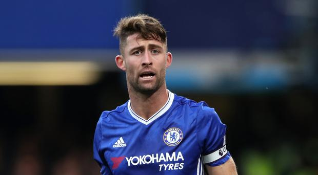 Gary Cahill says record-seeking Chelsea must stay focused on the task in hand and beat Tottenham