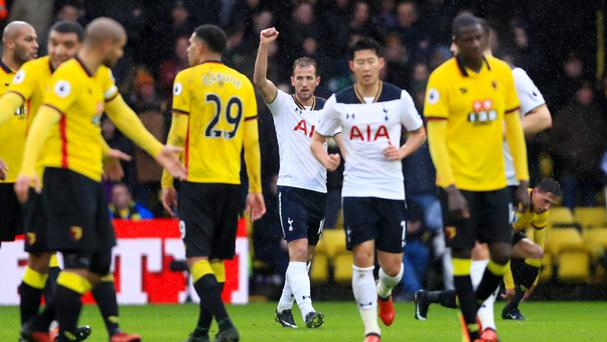 Tottenham striker Harry Kane (centre) celebrates scoring his first goal against Watford