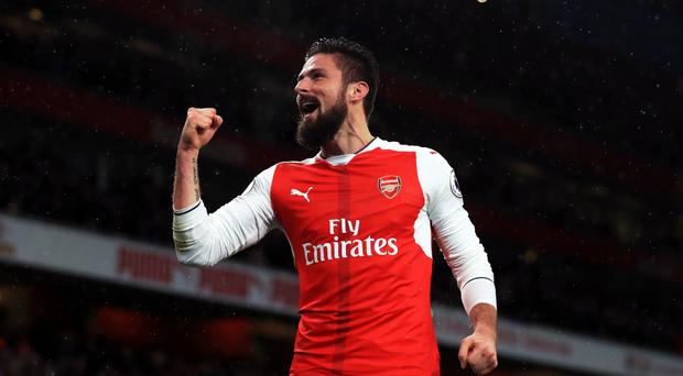 Olivier Giroud scored a wonder goal to help Arsenal to a 2-0 victory over Crystal Palace