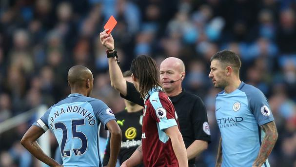 Manchester City's Fernandinho is shown the red card by referee Lee Mason