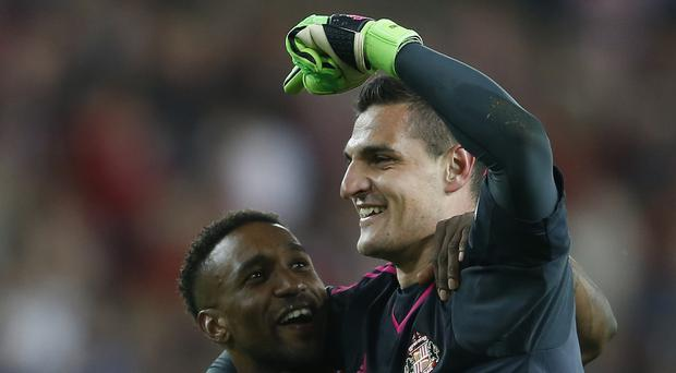 Jermain Defoe, left, was not the only player to impress for Sunderland against Liverpool. Goalkeeper Vito Mannone, right, was in good form in the Premier League match at the Stadium of Light.