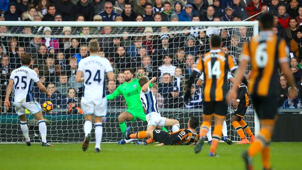 Robert Snodgrass (on the floor) opened the scoring for Hull before West Brom recovered to win 3-1.