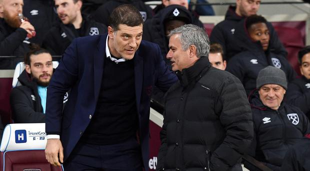 Slaven Bilic, left, rued decisions from the match officials while Jose Mourinho enjoyed a hard-fought win