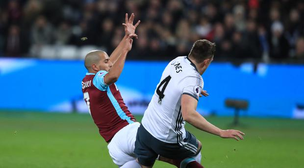 West Ham's Sofiane Feghouli, left, was sent off for a foul on Phil Jones