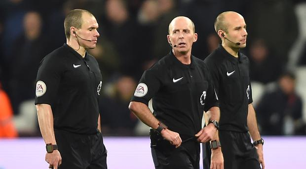 Mike Dean, centre, was criticised for sending off West Ham's Sofiane Feghouli
