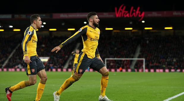 Olivier Giroud, right, netted a late Arsenal equaliser at Bournemouth
