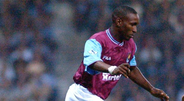 Former West Ham striker Tony Cottee would like to see Jermain Defoe, pictured, return to the east London club