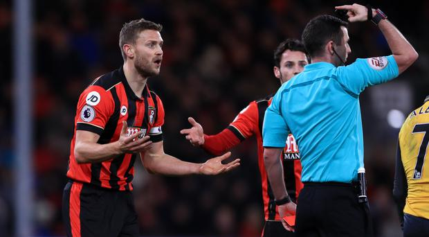 Bournemouth defender Simon Francis, left, was sent off by referee Michael Oliver late on during the 3-3 draw against Arsenal