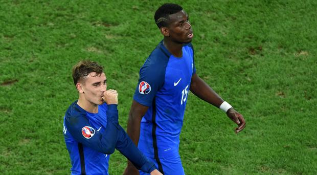 Antoine Griezmann, left, and Paul Pogba may soon be playing together at Manchester United, according to reports