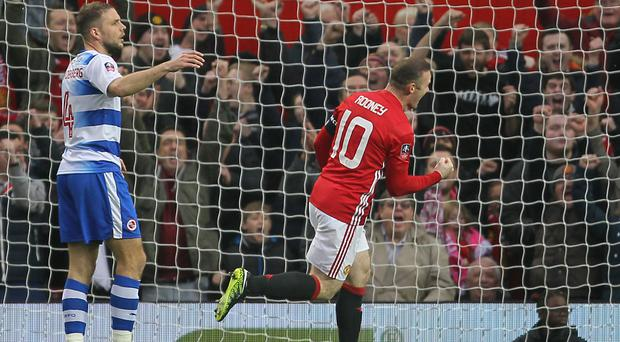 Wayne Rooney, right, celebrates his 249th Manchester United goal