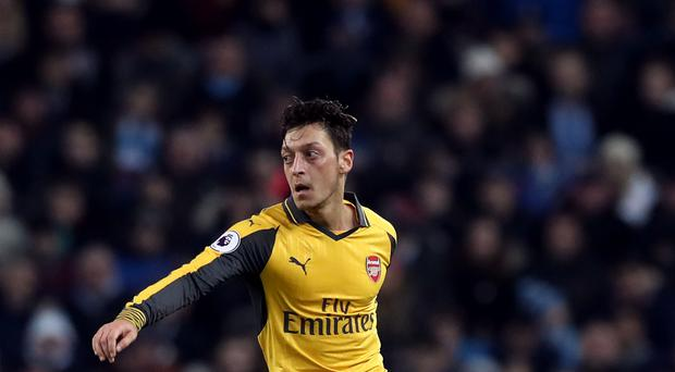 Mesut Ozil moved to Arsenal from Real Madrid in 2013
