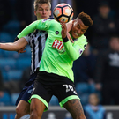 Heads up: Tyrone Mings rises with rival Shaun Hutchinson
