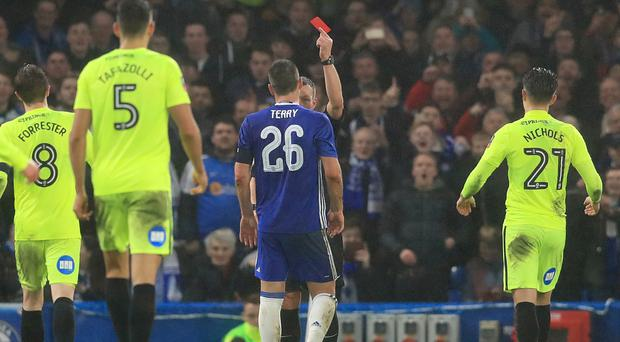 Head coach Antonio Conte says Chelsea are considering an appeal after John Terry (pictured) was sent off against Peterborough