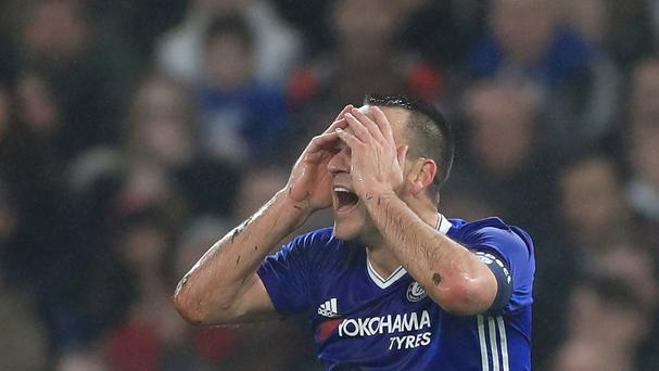 Chelsea defender John Terry could not believe he was shown a red card in the FA Cup tie against Peterborough, but must serve a one-match suspension