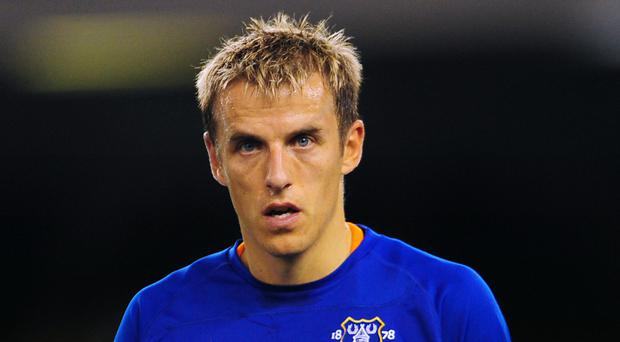 Phil Neville had lengthy spells both with Manchester United and Everton