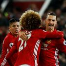 Manchester United's Zlatan Ibrahimovic (right) celebrates scoring his side's first goal with team-mates Marouane Fellaini (centre) and Marcos Rojo during the Premier League match at Old Trafford, Manchester.